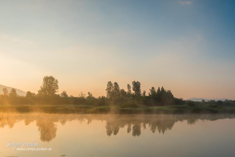 Sonnenaufgang am Zirknitzer See, Cerknisko jezero, Sickersee, Zirknitzer Becken, Naturschutzgebiet Rakov Škocjan , Slowenien